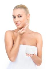 Beautiful women applying moisturizer cosmetic cream