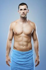 Young muscular man in bathroom