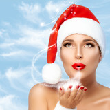 Magical Christmas Woman in Santa Hat Blowing Sparkling Stardust poster