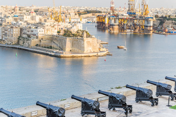 old gun in La Valletta and Fort St Angelo of La Vittoriosa in Ma