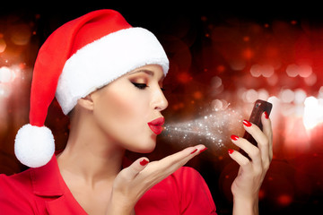 Christmas Woman in Santa Hat Taking a Selfie Sending Kisses