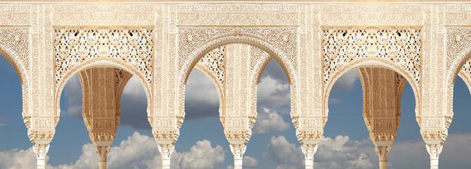 Arches in Islamic (Moorish)  style in Alhambra, Granada, Spain