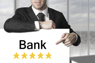 businessman pointing on sign bank