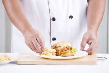 chef preparing a burger