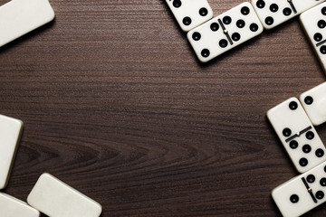 domino pieces over wooden table background