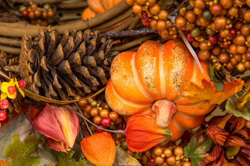 Fall colors home decorations - pumpkin and pine cones