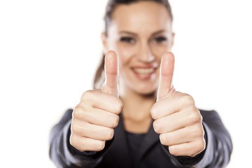 Beautiful business woman showing thumbs up