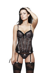 Sexy brunette woman in corset isolated