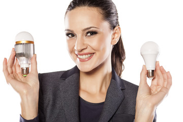smiling business woman showing a new generation of LED bulbs