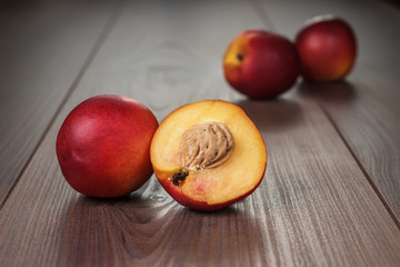 some fresh nectarines over wooden background