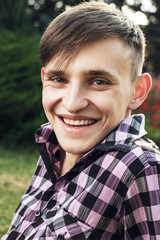 portrait of happy young man in park