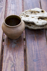 Clay pot on a wooden table