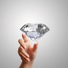 hand holding 3d diamond over white background