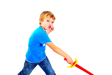 Young boy in studio playing with sword on white background