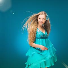 Summer. Sky. Girl in a sundress. Long hair. Wind. Fantasy.