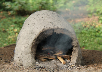 A Wood Burning Fire in an Outdoor Clay Oven.