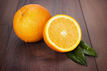 fresh oranges on brown wooden table