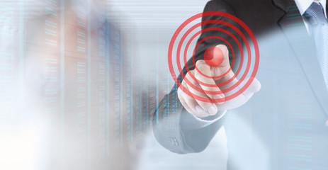 businessman hand shows target symbol as business concept