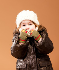 Cute girl in her winter cold weather clothing