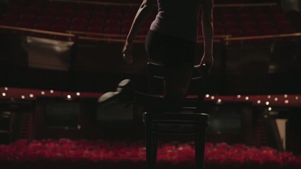 girl  dances in an empty theater
