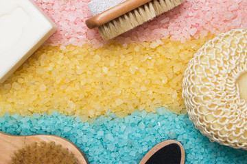 pink blue yellow bath salt and bath accessories