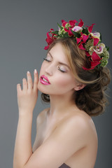 Sensuality. Luxurious Female with Classic Wreath of Flowers