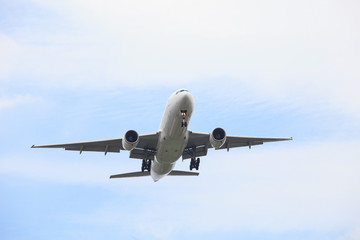 passenger jet plane flying against beautiful blue sky with copy
