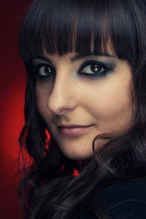 portrait of a beautiful brunette girl over red background