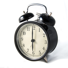Vintage black clock on white background