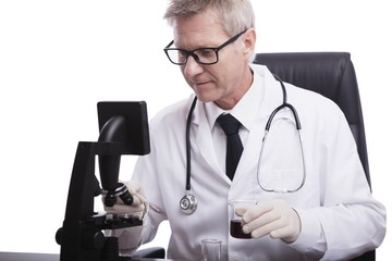 doctor look and analyse blood test tube