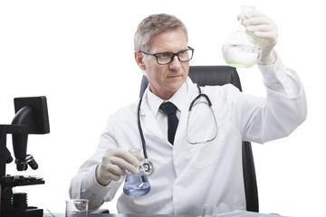 doctor look and analyse liquid test tube