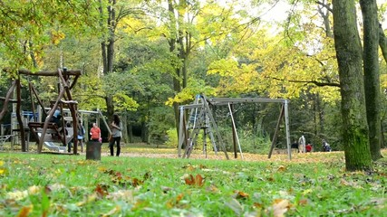 Playground - people relax - Autumn park (forest) - Fallen leaves