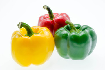 three fresh sweet pepper isolated on white background
