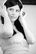 Black and white portrait of beautiful woman listening music