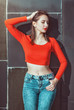 Young beautiful girl in red blouse enjoy sunlight