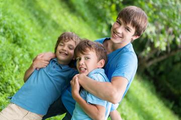 Portrait of three happy brothers