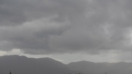 Storm clouds at mountain. Time Lapse
