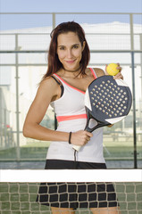 Woman posing in paddle tennis court
