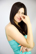 Gorgeous shy brunette woman smiling in studio