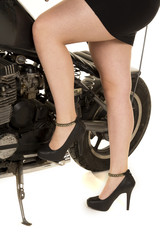 woman legs by motorcycle one up