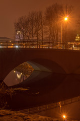 Bridge with reflection in the water at night.