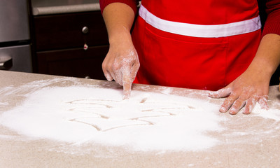 woman drawing into flour
