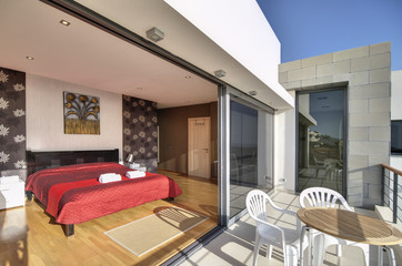 bedroom with balcony in the modern villa