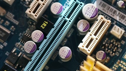 Computer main board with expansion slot closeup in motion
