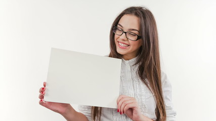 Teenager girl hold white blank paper