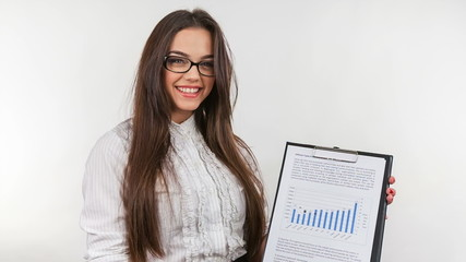 Woman holding a document with bar chart showing positive trend