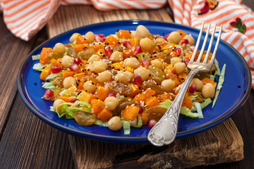 salad with chickpeas, raisins, sesame seeds and roasted pumpkin