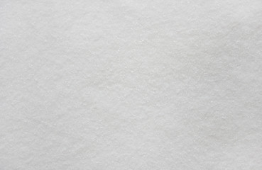background of white coarse sea salt small grains milky