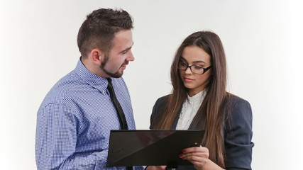Businessman and businesswoman looking at documents in a folder