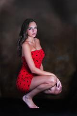 Model beauty portrait in red polka dot dress